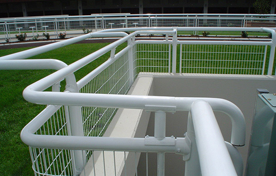 Close view of some white painted yard railing.